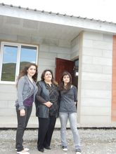 The Andreasyan family in front of new house
