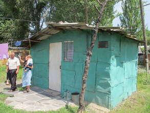 The metal shacks where many families still live