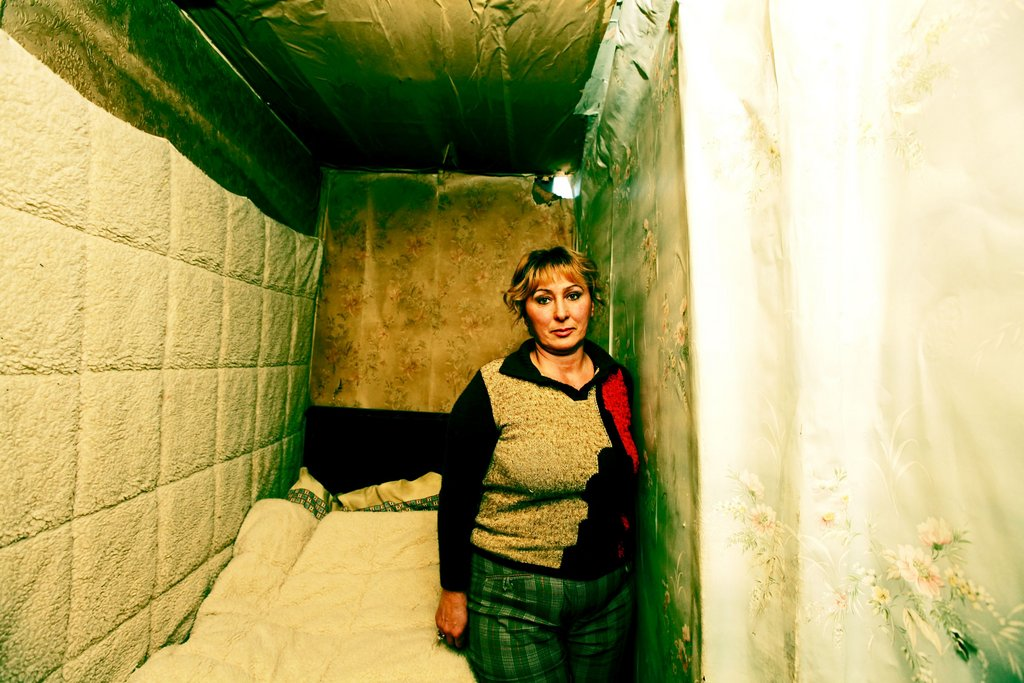 Nune Sakakyan, in her bedroom in metal conatiner