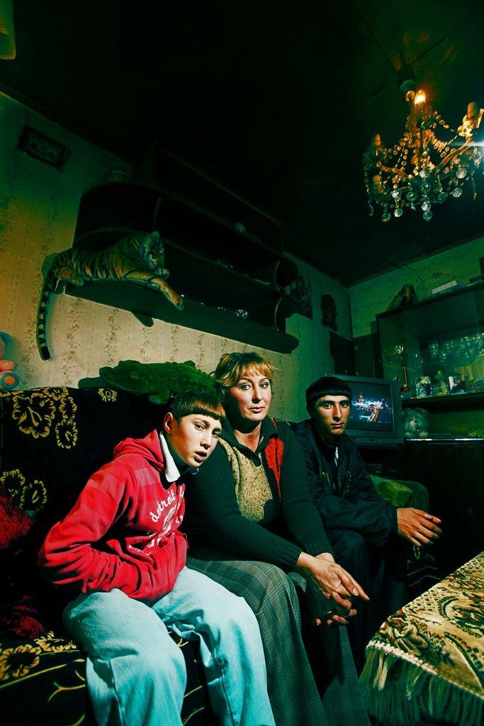 "The Sakakyan family in their ""home""/domik"