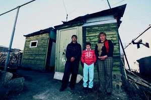 "The Sakakyan family outside of their ""home""/domik"