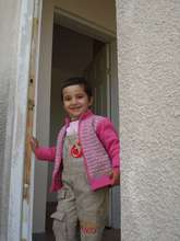 A child entering to her new house.