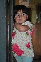 a child at the entrance of metal container-home