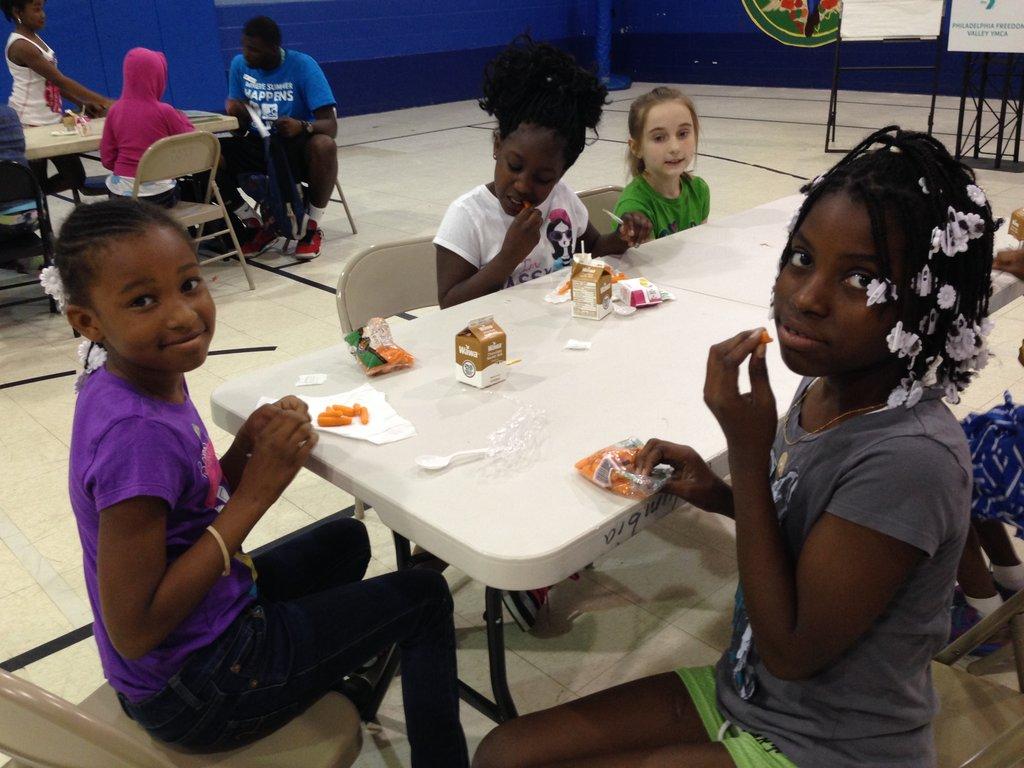 Girls enjoy a free summer meal.