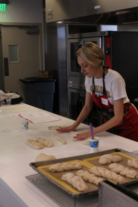 Challah For Hunger demonstration in the kitchen.