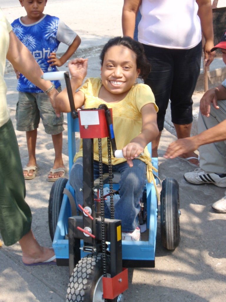 Lizeth receives a PET in Honduras. She was small in stature and was unable to walk distances.  She finished high school and wanted to go to college, but her underdeveloped legs and turned-out feet prevented her walking there.  We provided a child size PET to provide Lizeth mobility.