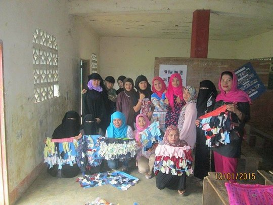 Jopay (blue scarf) with some of youth trainees
