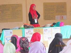 Jopay facilitating a training for young women