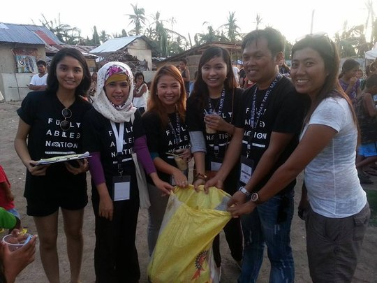 Ash with her Christian counterparts delivering aid