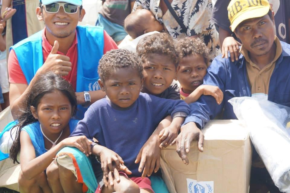 Jalanie (in blue cap) with Typhoon survivors