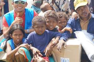 Jalanie (in blue cap) with Typhoon survivors