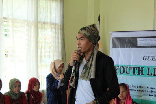Hamza facilitating a youth listening session