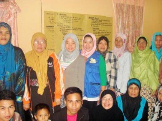 Babylove (in grey) with the women of Lumbatan