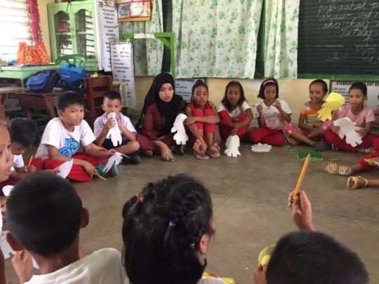 KI volunteer Naida facilitating recovery session