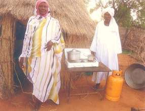 Mahdi Abu and his wife in front of their home.