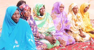 Women Participate in a Community Meeting