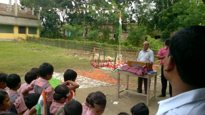 School assembly with flag-raising ceremony