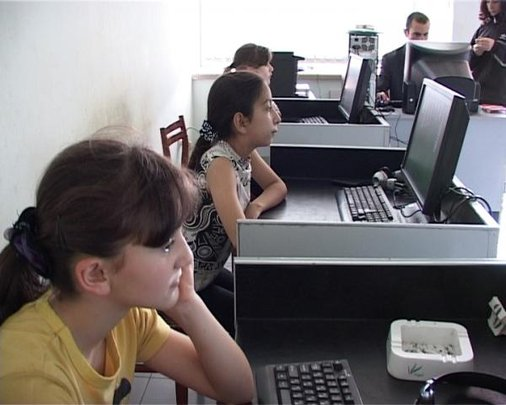 Youth use computers in rural Armenia.