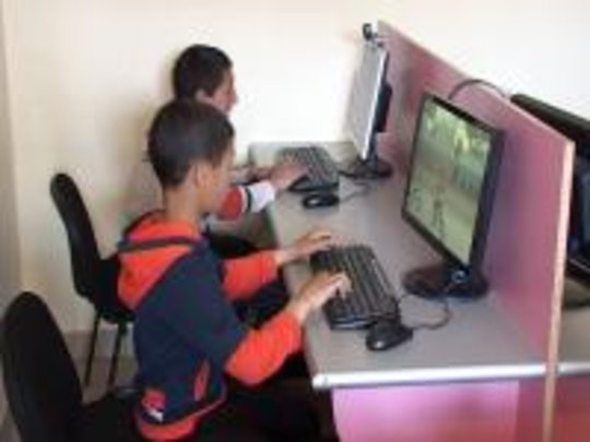 Village children learn computing at new IT center