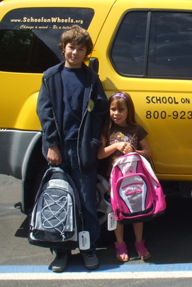 Students receiving backpacks and school supplies