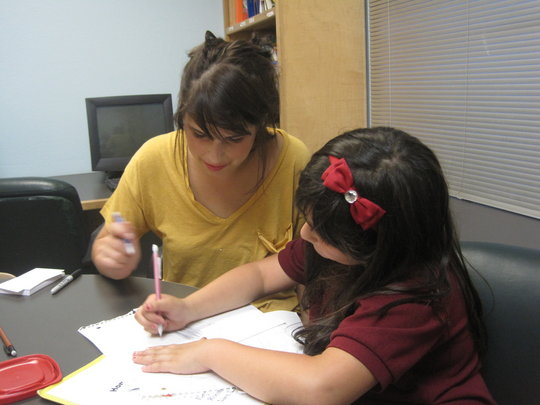 Student and tutor working together on homework