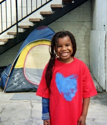 Photo of a School on Wheels student standing outside our Skid Row Learning Center