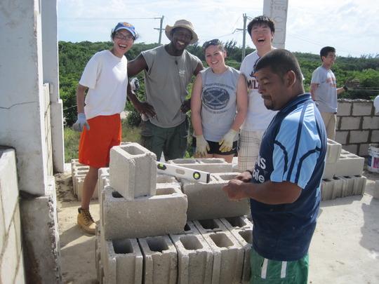Volunteers laying classroom blocks
