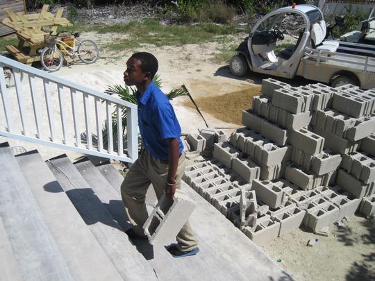 Ocean Academy student carries blocks upstairs
