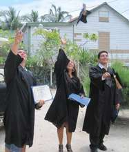 The graduates celebrate with hats flung high
