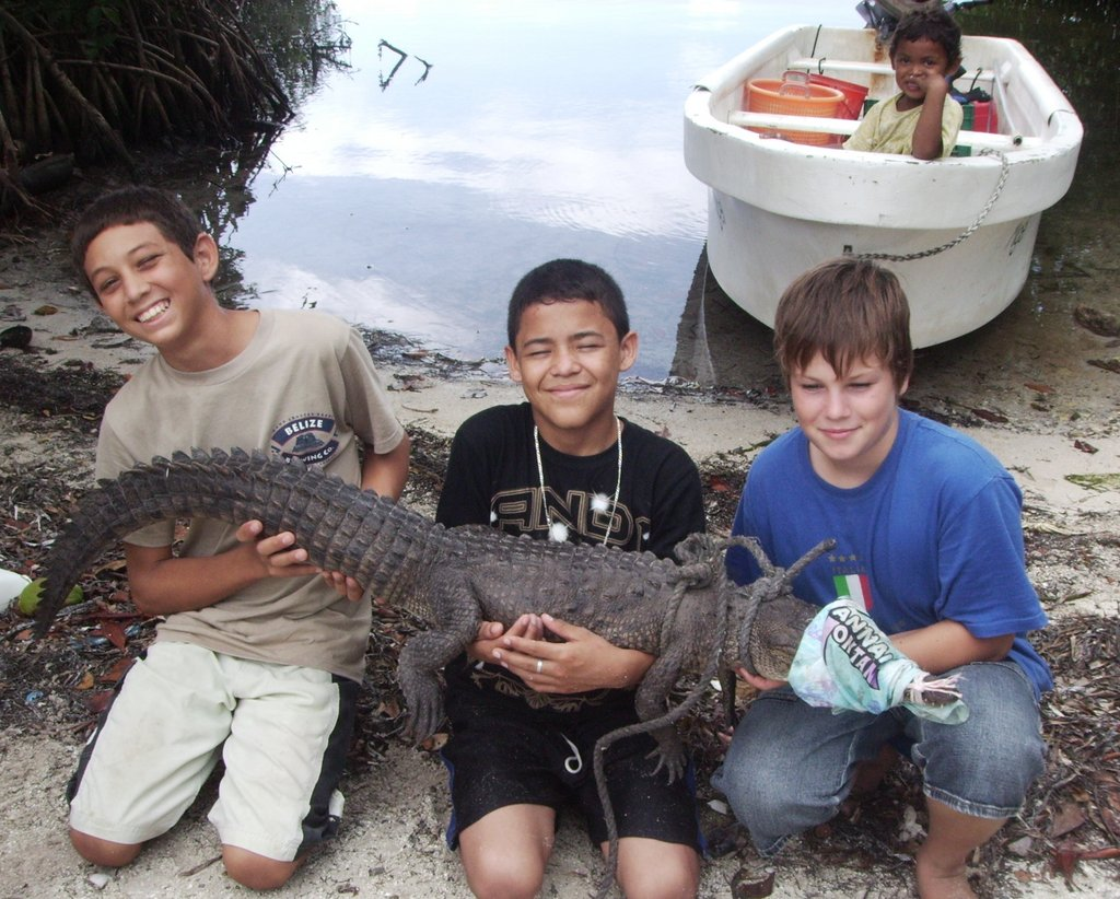 Crocodile Hunters!  Ocean Academy students caught this neighbourhood crocodile to tag and release as part of their marine biology studies.  An even bigger one lives in the mangroves near the steps of our school!
