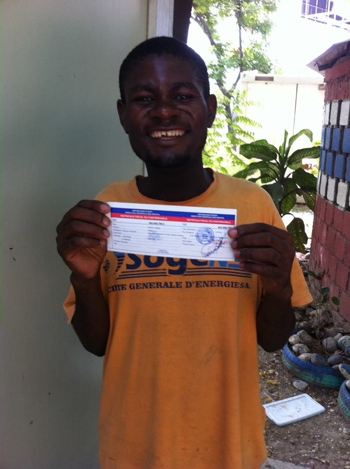 Omel smiling big with his birth certificate!