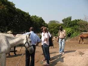 Miriam & Aluizah with ex jockeys & groomers