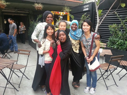 Staff with Darfuri and Karen tutoring students