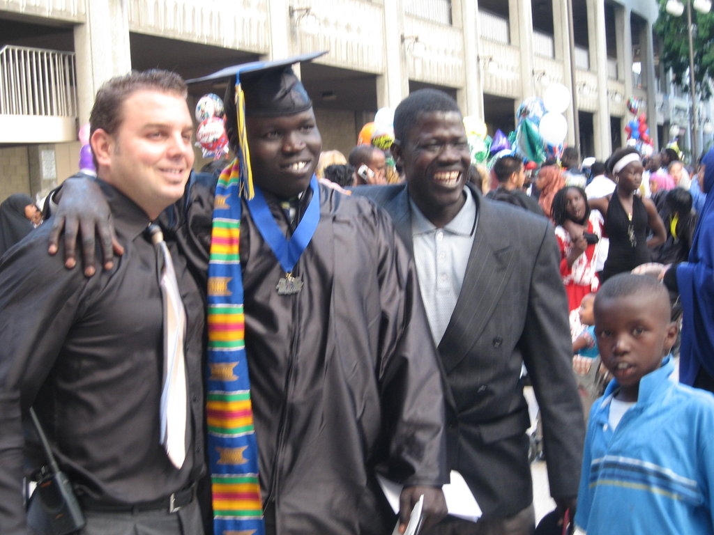 The football player, graduating from High school