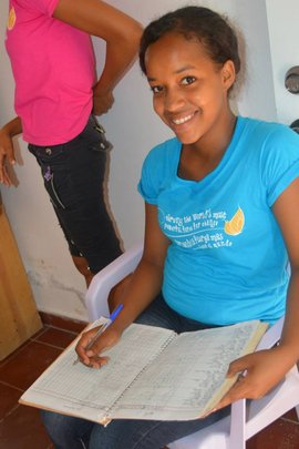 Fernanda taking attendance in the Main Office