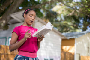 Erika, age 15, reads aloud during book club