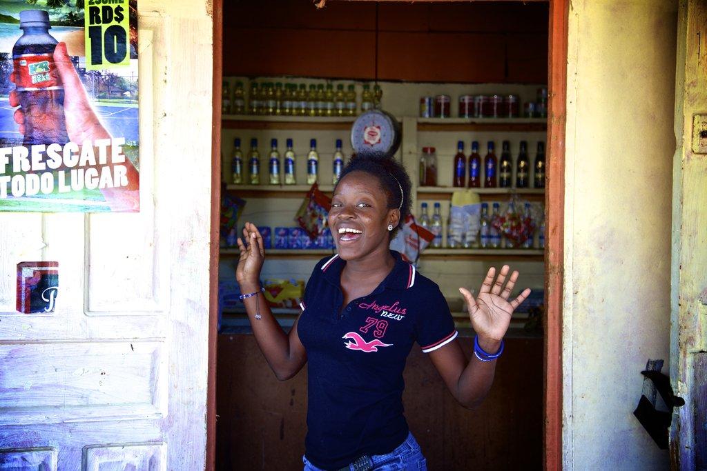 Ana Iris at the colmado purchasing supplies!