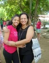 Jafreisy & Laura Pena hug after inspirational week