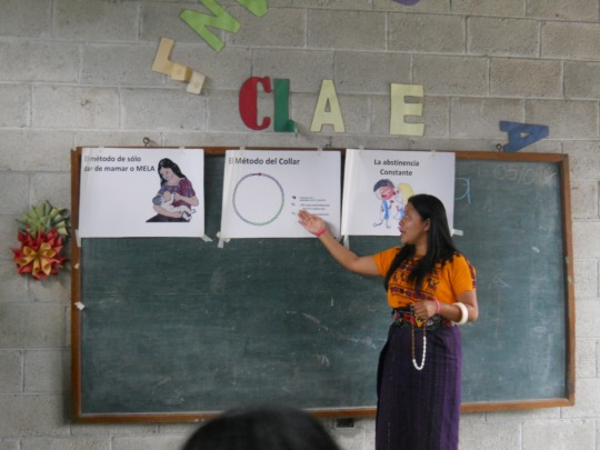 Rebeca, part of the MCH team, leading a charla