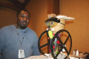 Veteran with his sculpture