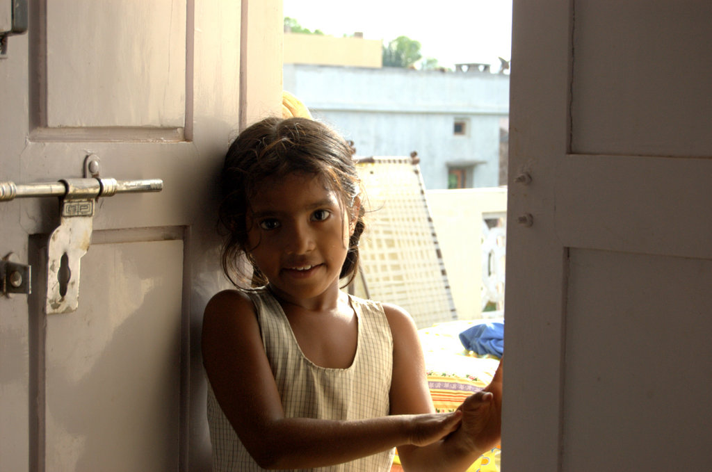 Brimming with Hope - Malli, a servant in the village, is filled with hope for a brighter future.