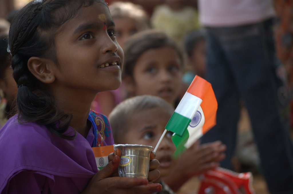 Patriotism - Taken during a student-led presentation, a small girl in the village looks up proudly on India