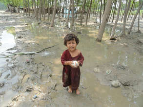 A child playing in her flood-affected neighborhood
