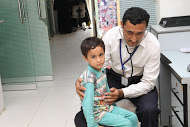 Child being examined - Baldia Town, 2014