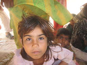Child displaced from Sultanabad due to floods