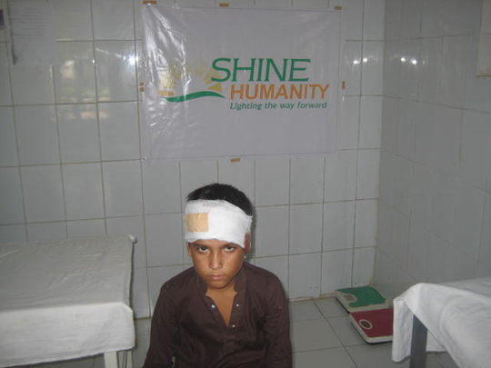 Child with bandaged head wound  SHINE -Aasra Gha