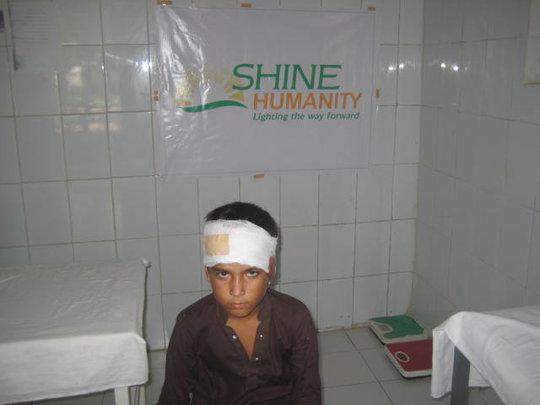 Child with bandaged head wound  SHINE -Aasra Gha