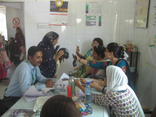Dr. Sherali wth physicans and patient