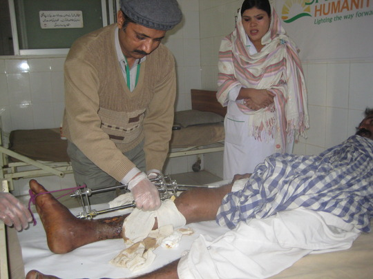 Dressing Qamar's wound