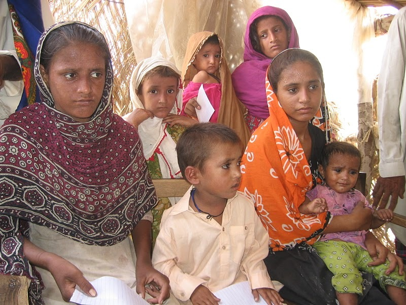 Mothers with children waiting in line